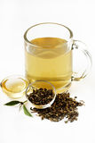 Green tea. A cup of green tea with honey isolated on white Royalty Free Stock Photo
