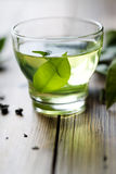 Green tea. Fresh green tea, backlit on rustic table Stock Photo