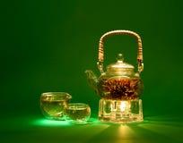 Green tea. Chinese green tea in a glass teapot royalty free stock photos
