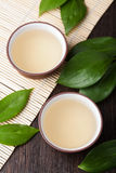 Green tea. Oolong in cups Royalty Free Stock Image