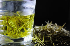 Green tea. In a glass cup on black background Royalty Free Stock Photo