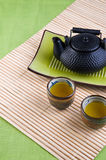 Green tea. In a cup on a green background Royalty Free Stock Image