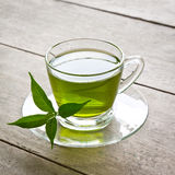 Green tea. A cup of green tea on wood board, drink for health Stock Image