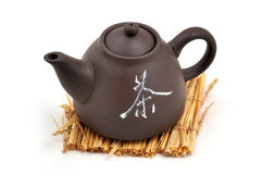 Green tea. Teapot with green tea isolated Stock Image