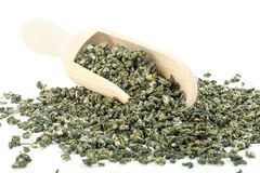 Green tea. Leaves full frame and wooden scoop Stock Images
