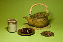 Green Tea. Japanese genmaicha tea and ceramic cup and teapot Stock Photography