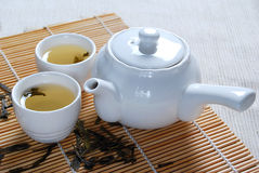 Green Tea 3. Enjoy your life style with a cup of green tea. Good for your health.Asian tea set on bamboo mat stock photography