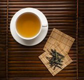 Green tea. In a white cup on a dark background Royalty Free Stock Photography