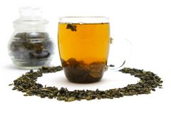 Green tea. Glass of green tea and phial Royalty Free Stock Photos