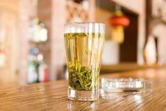 Green tea. On a hardwood table Stock Image