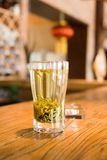 Green tea. On a hardwood table Royalty Free Stock Image