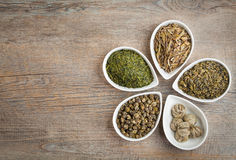 Green Tea. An assortment of loose dried Green Teas on a wooden background with copyspace stock photo
