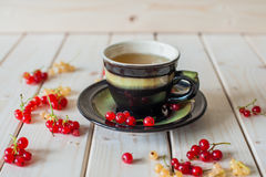 Green tea, bagel and currant stock image
