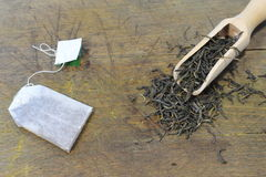 Green tea bags and green tea leaf. comparison Royalty Free Stock Photos