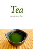 Green tea on bamboo mat(Green tea and chopsticks) with sample te Royalty Free Stock Image