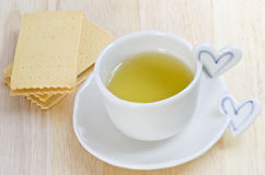 Green tea and biscuit Stock Images