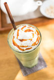 Green tea blended frappuccino with whipping cream Royalty Free Stock Image
