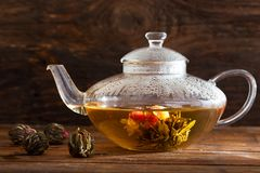 Green tea. Blooming flower in glass teapot royalty free stock photography