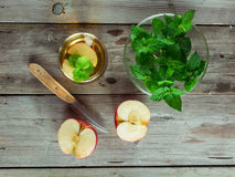 Green tea, a bowl with mint and cut apple Stock Photography