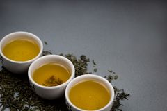 Green tea bowls. With dry green tea leaves Royalty Free Stock Images