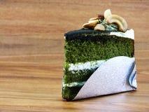 Green tea cake. With cream and cashew nut Stock Photos