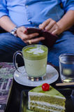 green tea cake with a a cup of hot green tea latte Stock Image