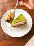 Green tea cake. Eating green tea cake and coffee or chocolate Royalty Free Stock Photo