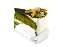 Green tea cake. Green tea layer cake on wooden background Stock Image