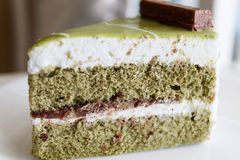 Green tea cake with red bean paste layer Stock Images