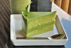 Green tea cake with tea leaf decorated Royalty Free Stock Photography