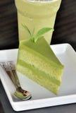Green tea cake with tea leaf garnish Royalty Free Stock Photo