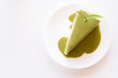 Green tea cake on a white dish. stock photo