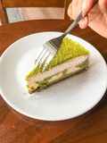 Green tea cake. Women eating green tea Royalty Free Stock Photos