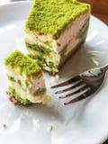 Green tea cake. Women eating green tea Royalty Free Stock Images