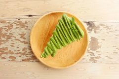 Green tea cake with wood plate on old table Stock Photo