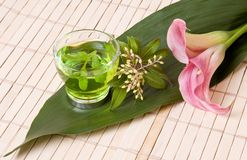 Green tea and calla flowers Stock Photography