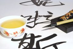 Green tea and calligraphy Royalty Free Stock Photography