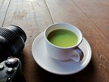 Green tea and camera stock photo