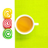 Green tea and candy Stock Images
