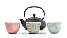 Green tea in cast-iron teapot. With small cups isolated on white background Stock Photo