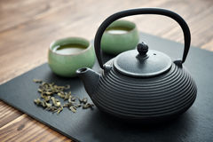 Green tea in cast-iron teapot Royalty Free Stock Image