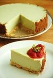 Green tea cheesecake with strawberry on white dish Royalty Free Stock Photo