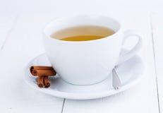 Green tea and cinnamon on wooden table. Stock Photo