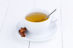 Green tea and cinnamon on wooden table. Royalty Free Stock Photos