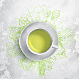 Green tea with circle ecology doodles. Sketched eco elements with cup of green tea. Green tea with ecology doodles. Sketched eco elements with cup of green tea royalty free stock photos