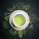 Green tea with circle ecology doodles. Sketched eco elements with cup of green tea Royalty Free Stock Photography