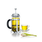 Green tea. Close up view of french press and a cup of green tea wuth lemongrass on white background Stock Photography