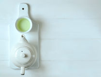Green tea concept. Green tea in tea pot and white cups, top view Stock Image