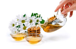 Green tea with cookies and flowers Stock Photography