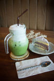 Green tea cool milk and tasty cake in coffee shop Royalty Free Stock Photo